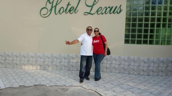 me and my husband in front of the hotel lexus. - picture of hotel