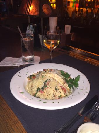 Sevy's Grill: Angel hair pasta with chicken and I ordered the salmon with BBQ sauce. Omg! We must eat! Review