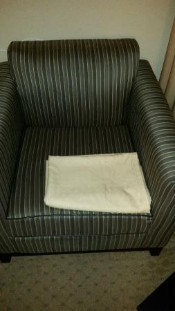 Holiday Inn East Windsor - Cranbury Area: One day housekeeping left the decorative pieces that go on top of the duvet folded on the chair