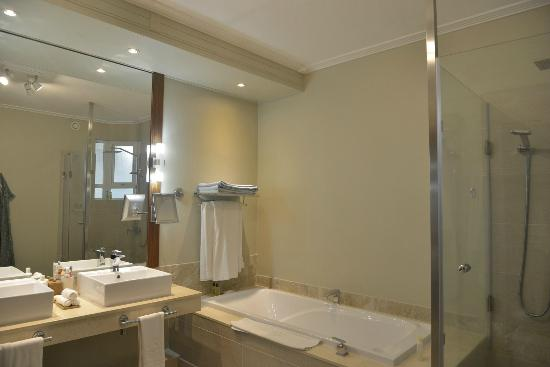 Shandrani Beachcomber Resort & Spa: Bathroom with his & hers wash basins, a huge tub, and separate shower area (not in photo).