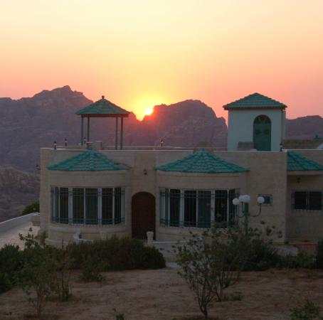 B&B Petra Fig Tree Villa with sunset over the Petra mountains.