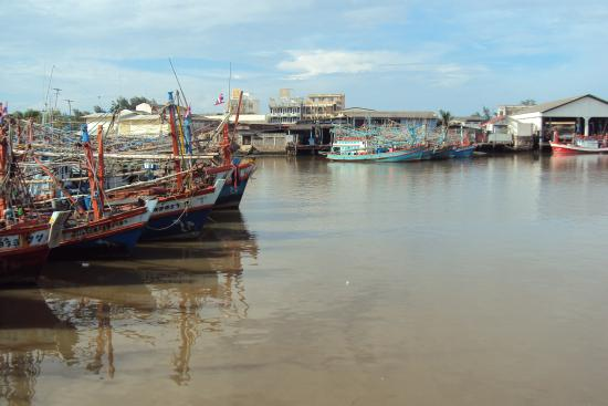 Colourful Thai fishing boats at harbour on the Rayong River