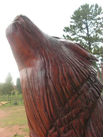 Divide, CO: Wolf carved wooden sculpture.