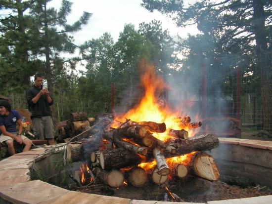 Divide, CO: Huge bonfire and staff members.