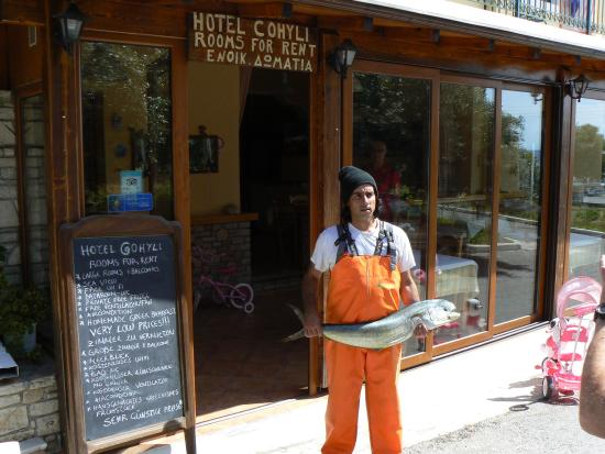Hotel Cohyli: Yannis back with our fish for dinner