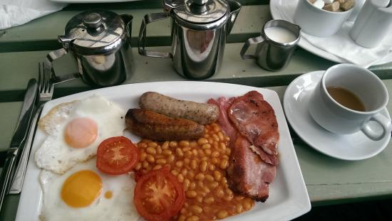Cobblestones Cafe: A cup of tea, plus the fry-up (go big for extra £1.50). Toast not in shot.
