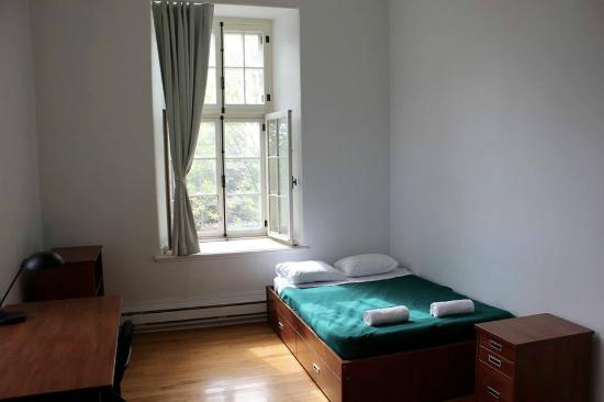 Grey Nuns Residence: $69/night Double bed with a sink!