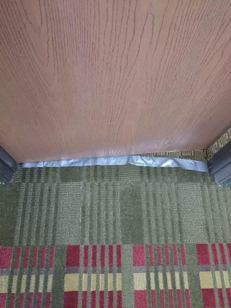 Days Inn McPherson: Duct Tape on Carpeting
