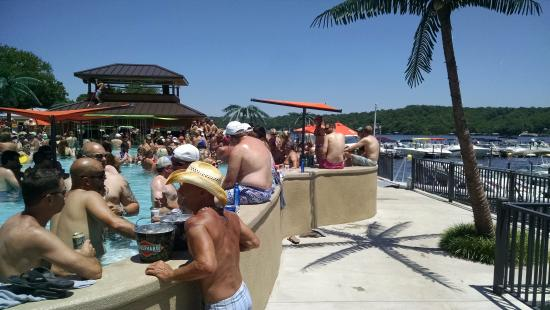 Coconuts Caribbean Beach Bar & Grill: Several Bars in and out of the pool