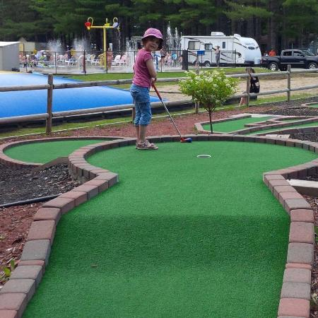 Cardinal/Ottawa South KOA: CC trying her first mini-put game... she even had a hole in one :-)