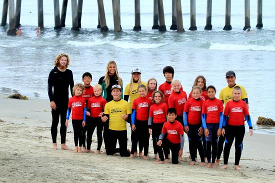 Hb Surf School Camp Students And Instructors Pose For A Group Photo