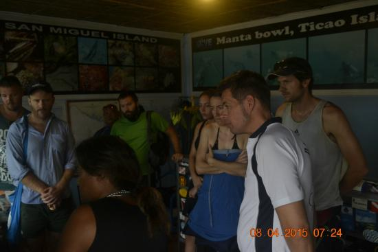 Bicol Dive Center: Our Divemaster guide having  a dive briefing before headout.