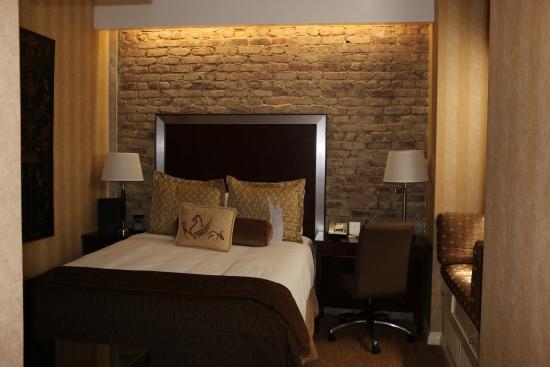 Hotel Griffon A Greystone Beautiful Brick Wall Behind The Bed