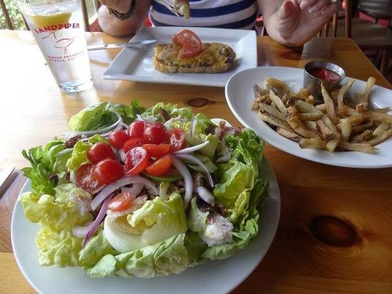Sandpiper Restaurant: Salad was good,but that open face sandwiche with no french fries inclued,was a bit over priced