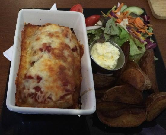 Flanagan's: Steaming hot, overcooked enchiladas with curdled sour cream