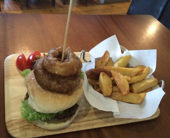 Flanagan's: Greasy burger and onion rings which oozed even more grease