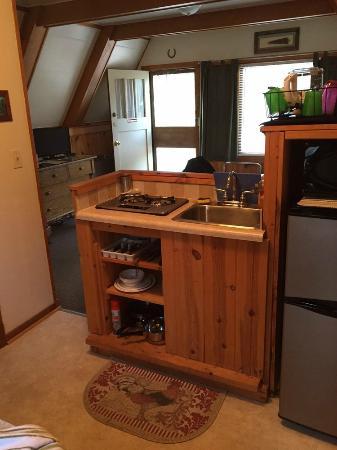 The Roost Resort: Kitchenette in cabin looking towards the front door