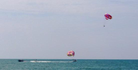 Ocean Watersports: Parasail in air & one by boat loading new passengers
