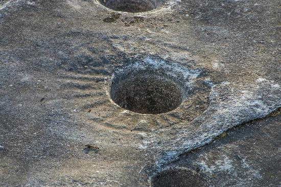 Indian Grinding Rock State Historic Park: Petroglyph surrounding one of the holes