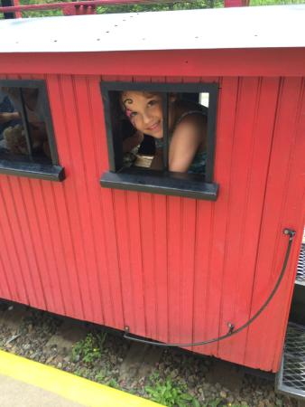 Tiny Town: One happy 5 year old in the caboose!