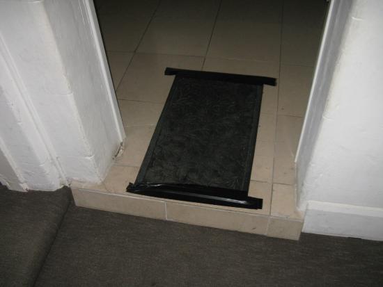 Bathurst Motor Inn: Mat taped over broken tiles