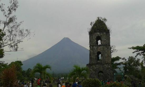 the beauty of mt mayon in Mount mayon, philippines - been here and it was active at the time so you could always see smoke coming out expansion and a poverty trap beauty of mount mayon.