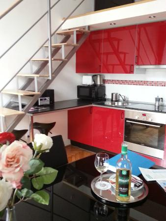 Welcome Budapest Apartments: Stairs to bedroom loft; kitchen/dining area