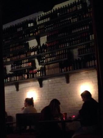 Churchkey: Upstairs - craft beer bottles line the wall