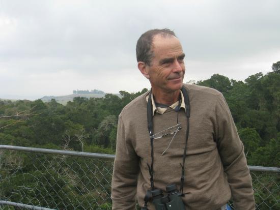 Happy man in Dlinza forest watching birds