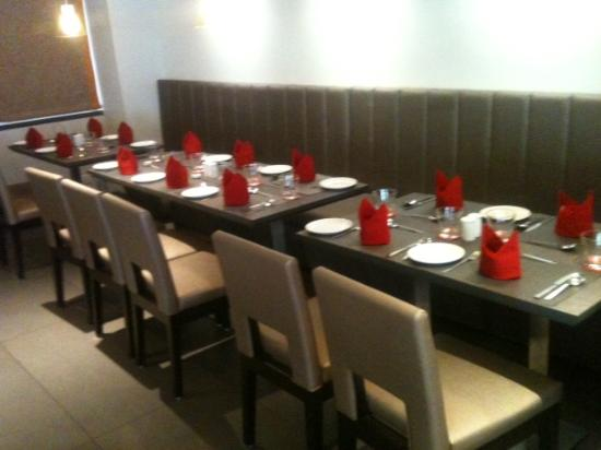 ZiP by Spree Hotels Vadodara: Bright red napkins adding romance to your meals..........