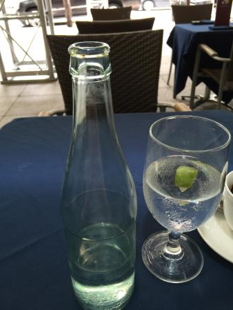 Shinbashi : Mineral water? With no label? And with rust around the neck?