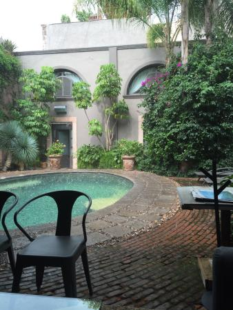El Meson Hotel: Beautiful from the covered patio, even in the afternoon shower!