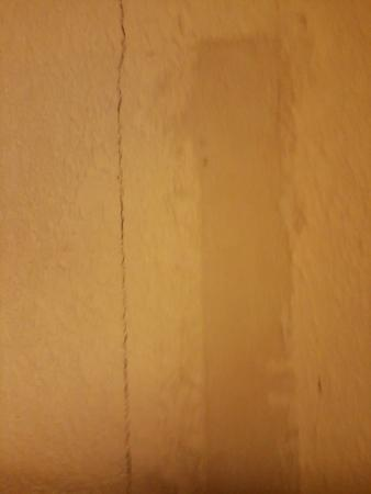 Wall by the bed at Quality Inn, Seymour IN.