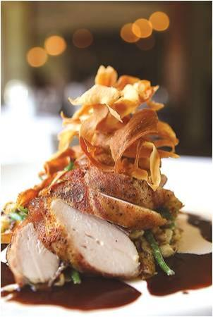 Evans Street Station: Bacon Wrapped Roasted Chicken Breast with Housemade Spaetzle, Lemon-Thyme Natural Reduction, and