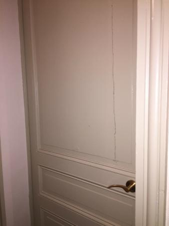 Hotel de la Paix: Bedroom door looks like someone tried to axe their way out!