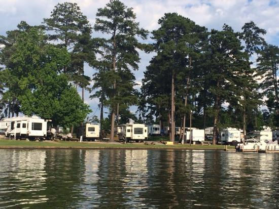 Milledgeville, GA: View of camping area near boat dock from water