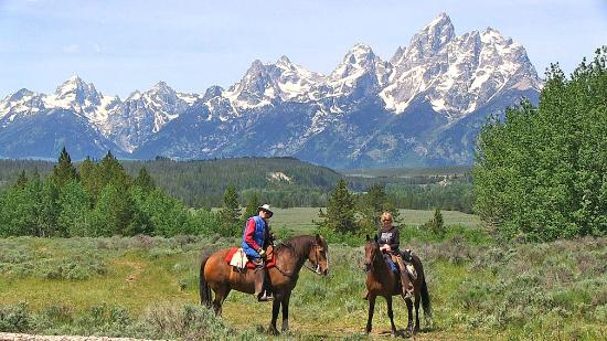 Triangle X Ranch: Riding with the Grand Tetons in the background