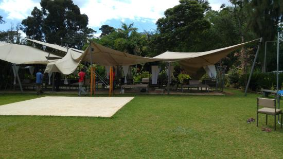 Tent seating picture of zen garden restaurant nairobi for Pool garden restaurant nairobi