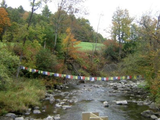 Barnet, VT: prayer flags crossing river near entrance
