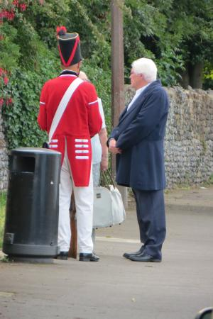 St Peter's Village Tour: Characters deep in conversation