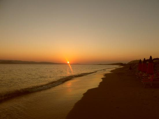Vlassis' Family: Sunset over Paros from the beach at Vlassis.