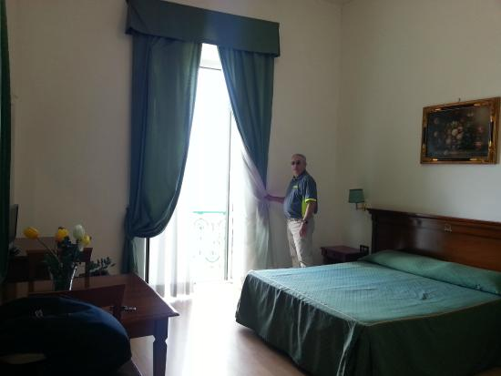 Our clean Hotel Miramare room had high ceilings, comfortable furnishings and sea view from balco