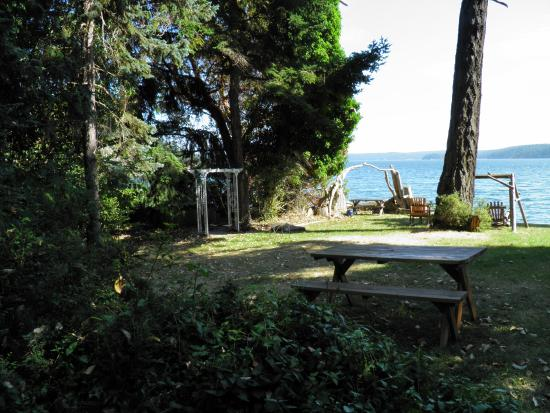 "Cabins on the Point: ""Lawn area and view from the cabin."""