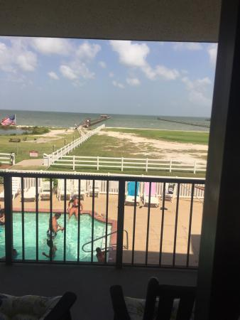 Laguna Reef Condominiums: Our perfect view from condos 210& 211. Kids were in the pool right in front of our balcony. Fish