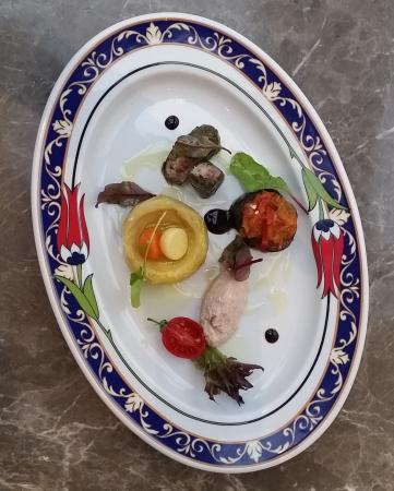Ankara HiltonSA: Turkish Mezze Platter ; vegetables in olive oil,hummus, grape leaves with rice,mini imam bayildi