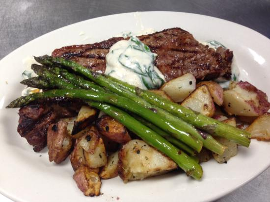The Copper Trout: Black Angus New York Strip with Blue Cheese and Spinach topping