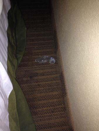 Extended Stay America - Chicago - Naperville - East: Used condom left between the bed and wall