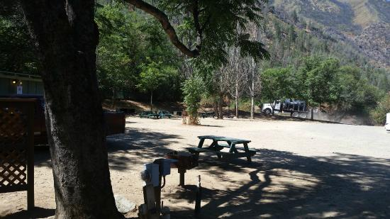 Indian Flat Campground: Select your tent site by that truck. Backwall, away from Hwy.