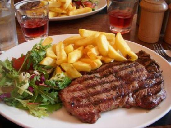 Aussie Pub Kamala: A beautiful steak dinner with salad and chips.. N.Z or Aussie steak, can't recall sorry.