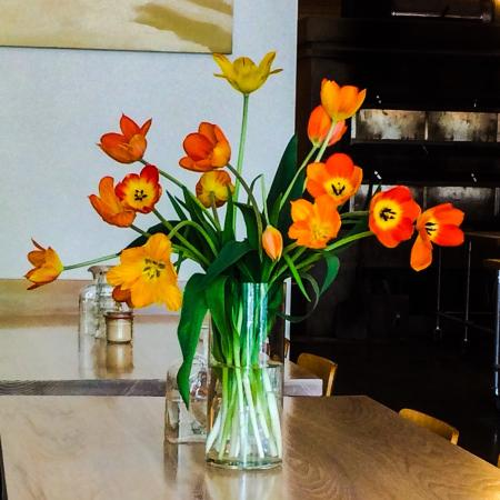 Vergennes Laundry: There are always lovely flower arrangements at the tables